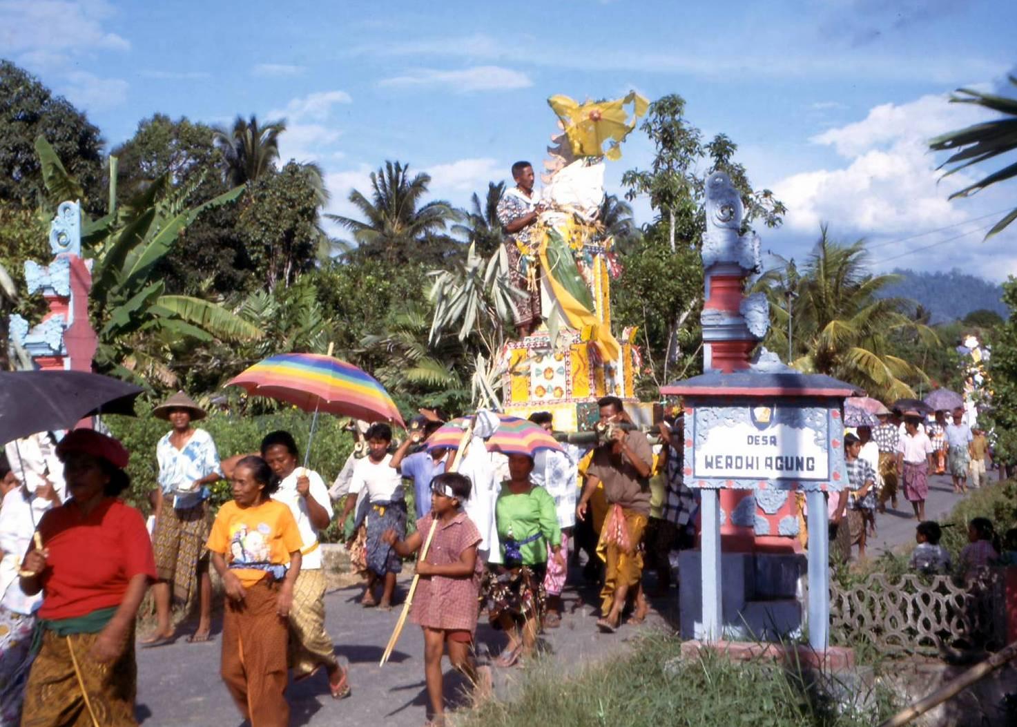 A funeral procession leaves Desa Werdhi Agung